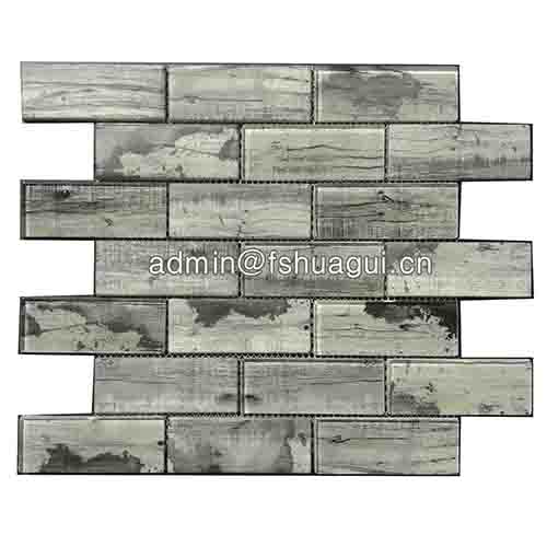 Grey inkjet brick glass subway tile around fireplace
